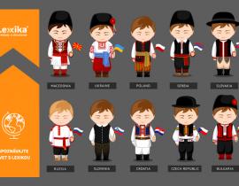 Muži v slovanských krojoch so zástavami v ruke